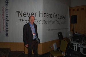 "The NHF UK - AV5 - President of The NHF Scott Tips in Front of the ""Ever Heard Of Codex? That's Exactly What They Want!"" Sign"